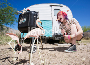 stock-photo-6347594-girl-in-front-of-trailer-eating-a-hotdog